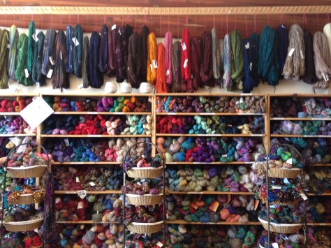 Wall of yarn in Black Sheep. That's Malabrigo Mecha hanging on top.